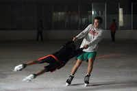 Conner Brady, 17, swings his younger brother Graham Brady, 12, both of South Lake, during Laser Skate night at Polar Ice in Grapevine Mills mall, on June 29, 2013 in Grapevine.