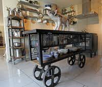 An industrial rolling cart from El Paso Imports serves as an island, but it doubles as a rolling drinks bar when he and his partner entertain.