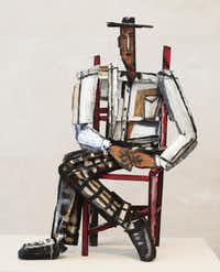 """This painted bronze titled, """"Man in Red Chair"""", 1994, is on display at the Nasher Sculpture Center in Dallas. The Modern and the Nasher Sculpture Center, present a joint exhibition of the work of artist David Bates, of Dallas, on view February 9 through May 11, 2014. The exhibition is a retrospective of Bates's work installed in both locations with an emphasis on painting in Fort Worth and sculpture and works on paper in Dallas. This is the first collaboration between the two museums. Shot on Wednesday, February 12,2014."""
