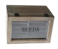 Keep track of seed packets in a small wood countertop box. $25.99 at North Haven Gardens, Dallas.