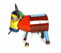 A colorful bull, made in Australia from recycled 44-gallon drums, has new life as a patio or tailgate cooler. No two are alike. $328 at Redenta's, Dallas and Arlington.
