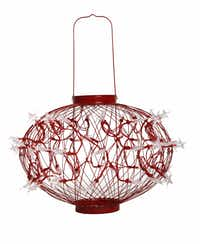The outdoor Solar Stars lantern is draped in clear LED stars that get their power from the sun and a small rechargeable battery. The light can be shaped into a sphere or a column. $59.99 each at North Haven Gardens, Dallas.