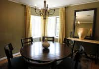 Johnson gave new life to the Dilbeck dining room by repainting walls a golden hue.