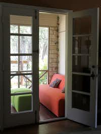 Johnson adds cushy furnishings in stylish, pleasing colors to rooms.