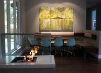 The Hortons' high-tech heat source is a vent-less, chimney-less fireplace fueled by denatured ethanol. Iconic Eames chairs and table outfit the casual dining nook.