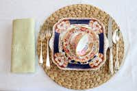 The Baskins dyed a vintage damask napkin apple green to complement Imari china.(Allison Slomowitz - Special Contributor)