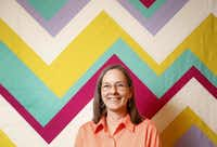 A portrait of Belinda Gelhausen who made quilts (in background) at Citycraft in Dallas, TX.(Kye R. Lee)