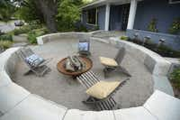 The upper part of the front garden features a gathering place that acts much like a front porch.
