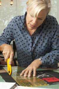 Quilt designer Shari Lidji cutting fabric for one of her modern quilts at her home studio in Dallas, Texas.