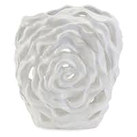 Flower power: The Rebecca ceramic cutwork vase features a crisp, high-gloss finish. $199 at Cantoni, Dallas, and cantoni.com.( Cantoni  - Cantoni)