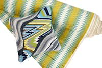 Flame Stitch patterns for home trend feature, photographed August 16, 2012. Bargello Jungle Road pillow (large), $150 by Jonathan Adler and Blue-green flame stitch fabric, $41.99/yard, at Fabric Yard.