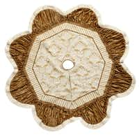 Surround a Christmas tree with a 72-inch round, ivory and gold tree skirt trimmed in faux fur with gold satin backing. $69.99 at TuesdayMorning.com and select Tuesday Morning stores