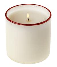Create a festive atmosphere with wafts of cranberry and currant from Lafco's Holiday Berry 16-ounce candle in a red-rimmed white glass container. $55 at Gray Living, McKinney; Paper Affair, Dallas, Plano, Frisco; and La Foofaraw, Plano
