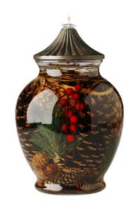 Warm hearth and home with a nature-inspired, ginger jar oil lamp. Filled with preserved pinecones and evergreens, the 6-inch-by-10-inch lamp burns odorless oil. $99 at Culinary Connection, Plano