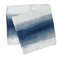 Perfect for every-night tabletop, LA artist Britt Browne designed this dip-dyed Brushstroke cotton, indigo-dye table runner for Terrain, $168, at shopterrain.com.