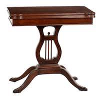 Dark wood vintage Game Table, $50, from The Samaritan Inn's thrift shop