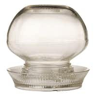 Under glass: Originally used as a chicken waterer, the glass orb with saucer makes a terrarium with a vintage appeal. $80 at B Gover Limited, Dallas.