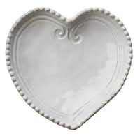 Italian romance: Inspired by Venetian lace, a handmade heart-shape dish by Vietri holds delectable sweets or elegant jewelry. The microwave-, oven-, freezer- and dishwasher-safe dish is packaged in a red gift box. $40 at Culinary Connection, Plano.