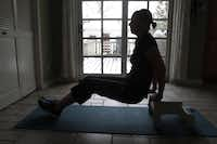 Louis recommends circuit training during home workouts, moving from exercise to exercise, including the tricep dip.