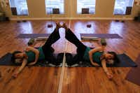 """Tamra Pierce, 29, 18 weeks pregnant, with a """"leg up the wall"""" pose during a prenatal yoga class, on March 15, 2012 at the Pranaa yoga studio in Plano."""