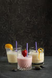 Left to right, Peach Shake, Strawberry-Banana Shake, and Orange Cooler, photographed September 19, 2012. These small serving drinks are for people undergoing cancer treatments that may have limited appetites. (Evans Caglage/The Dallas Morning News)Evans Caglage
