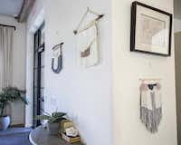 Woven wall hangings made by Rebekah Wright are on display on Friday, April 8, 2016 at Upper East Cafe in the Upper East Apartments at the Village in DallasAshley Landis - Staff Photographer