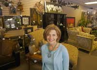 "One source of furniture at consignment stores is empty nesters. ""I hear constantly, 'My kids don't want it,"" says Jenny Verastique, owner of Furniture Buy Consignment.(Ron Baselice -  Staff Photographer )"