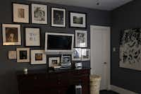 Heather Devers created an art wall with a collection of sentimental items to frame and de-emphasize a flat-screen television in the master bedroom.