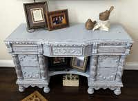 A desk in Donna Haile's living room bears one of the gray shades in  Miss Mustard Seed's Milk Paint palette.