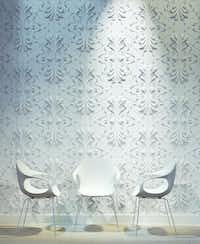 Sculptural surfaces bring walls to life with depth and visual interest. Constructed of natural gypsum components, interlocking panels from ModularArts are durable and fire-safe. Shown  is the Stella pattern available from modulararts.com.(ModularArts)