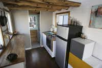 A view of the kitchen inside the tiny house built by Randi Hennigan and her husband, Cody Hennigan, which is parked at the Lakewood Brewing Company, in Garland, Texas Wednesday February 24, 2016. The Hennigans started building the house in March 2015. The 170 square foot home includes reclaimed wood floors, a projector screen for entertainment and a wood burning stove. (Andy Jacobsohn/The Dallas Morning News)( Photos by Andy Jacobsohn - Staff Photographer)