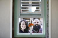 Randi Hennigan and her husband, Cody Hennigan, stand for a portrait outside their tiny house, which is parked at the Lakewood Brewing Company, in Garland, Texas Wednesday February 24, 2016. The Hennigans started building the house in March 2015. The 170 square foot home includes reclaimed wood floors, a projector screen for entertainment and a wood burning stove.(Andy Jacobsohn - Staff Photographer)