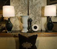 Area 25: Tomlinson silk sofa, $1675; pair of blue Murano lamps on crystal base, $695 each; set of four vintage prints, $445 each.( Ron Baselice  -  Staff Photographer )