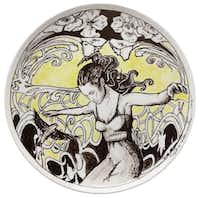 Enrique Fernández Cervantes, visual arts coordinator-curator at the Bath House Cultural Center, says he has no experience in ceramics but created a black-and-yellow plate with a figure of a woman floating through flowers.Evans Caglage - Staff Photographer