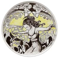 Enrique Fernández Cervantes, visual arts coordinator-curator at the Bath House Cultural Center, says he has no experience in ceramics but created a black-and-yellow plate with a figure of a woman floating through flowers.(Evans Caglage - Staff Photographer)