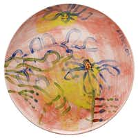 Mary Vernon, who has taught drawing and painting at Southern Methodist University for 47 years, was delighted to paint a plate for the auction, even though she hadn't done any work with ceramics since she was in college.(Evans Caglage - Staff Photographer)