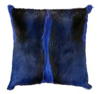 Fashion forward: Made from cobalt-dyed springbok hide, Outpost Original's glam pillow adds a bolt of color to any room. $265 at Nest, Dallas.