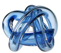 Knot now: Multiple hues of blue glow through this hand-blown glass knot by Czech company Sklo. $225 at Mecox Gardens, Dallas.