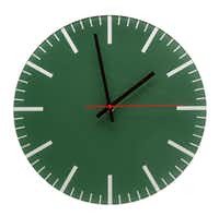 "It's a clock in a color that will stand the test of, ahem, time. ""Classic"" glass wall clock, $39, at BoConcept, Dallas."