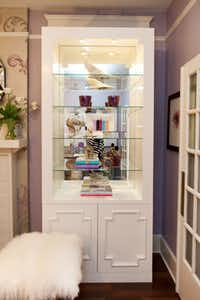Introducing mirrored and reflective pieces to a space increases the glamour factor, while adding natural light and opening up a space. Try installing mirrors on the back of a bookcase.