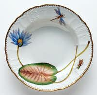 Botanic beauty: Anna Weatherley draws inspiration from 16th-, 17th- and 18th-century botanical art. Her resulting designs are hand-painted on china by Hungarian artists trained in Weatherley's studio. Though not technically watercolor, we love the way the hues fade with precision in each bloom, leaf and insect. Anna Weatherley's Seascape Waterlily Collection rimmed soup dish is $374 at Copper Lamp, Dallas.Supplied  - SUPPLIED