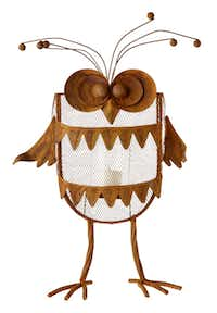 A raffish owl of rusty metal holds a votive or small pillar candle. $60 at Paper Affair, Dallas, Frisco and Plano.
