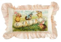 Easter bonnets adorn four sweet chicks on a 10-by-14-inch ruffled cotton pillow. Additional styles available. $22.75 at St. Michael's Woman's Exchange, Highland Park.