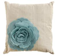 Pillows of linen and cotton, 16 inches square, are embellished with felt floral blooms. $32.95 at Sample House & Candle Shop, multiple locations.