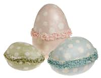 Papier-mache eggs in a rainbow of pastel colors stand alone or nest within each other to make a charming centerpiece for an Easter table. Set of 3, $120 from Mary Cates and Co., Dallas.