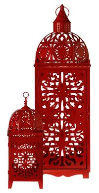 Color splash. Add a touch of Morocco with the playful bohemian metal lantern in punchy red. $129 for 35-inch model; $54.95 for 18-inch. Nicholson-Hardie Garden Center, Dallas.(Photos by Evans Caglage - Staff Photographer)