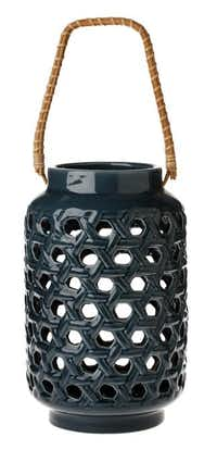 Well woven. Available in one of three neutral shades — soft green, cream or blue — you can mix, match and fill an entire table with the Threshold tabletop ceramic lantern. $19.99 at Target and target.com.Evans Caglage  -  Staff Photographer