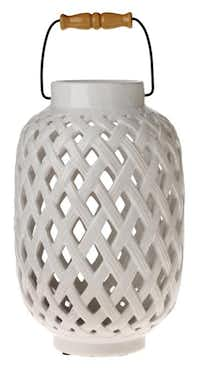 Well woven. Available in one of three neutral shades — soft green, cream or blue — you can mix, match and fill an entire table with the Threshold tabletop ceramic lantern. $19.99 at Target and target.com.( Evans Caglage  -  Staff Photographer )