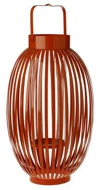 Tiki touch. Hang several from trees or set a few on the patio for a party with a '60s twist. Oval metal hurricane lantern in red or orange, $19.99 each. Brumley Gardens, Lake Highlands and Oak Cliff.( Evans Caglage  -  Staff Photographer )