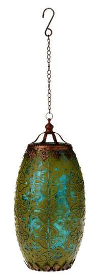 Boho glow. Light a path with painted mercury glass lanterns strung from hooks. This one casts a romantic glow when lighted with tealights. In green, $14.95 at Pier 1 Imports and pier1.com.Evans Caglage  -  Staff Photographer